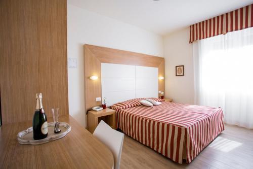 Letto o letti in una camera di Hotel Sylvia