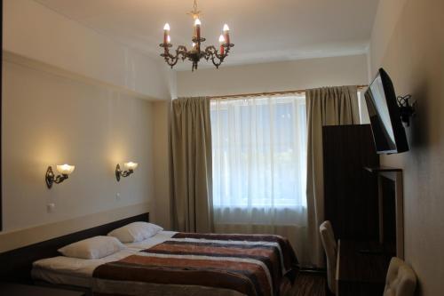 A bed or beds in a room at Ecoland Hotel