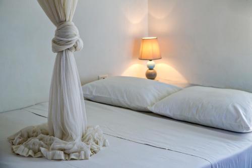 Кровать или кровати в номере La Casa Tinos