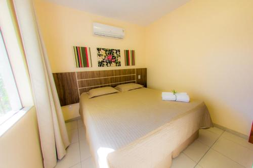A bed or beds in a room at Portinari Residence