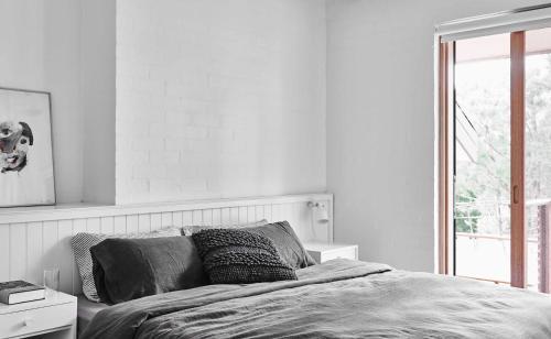 A bed or beds in a room at Seville Estate