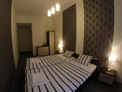 Łóżko lub łóżka w pokoju w obiekcie Brama Hostel