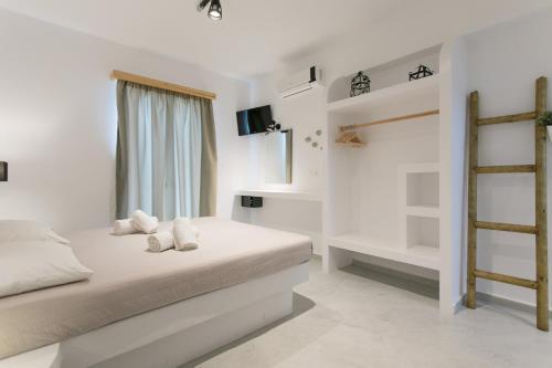 Ένα ή περισσότερα κρεβάτια σε δωμάτιο στο Naxos Colosseo