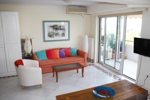 A seating area at Exclusive Apartment in Glyfada Centre, 1' to Beach