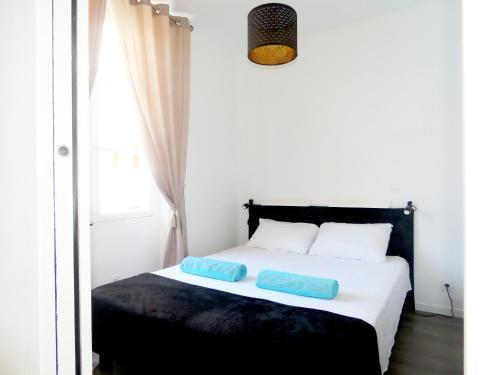 Кровать или кровати в номере La petite Maison