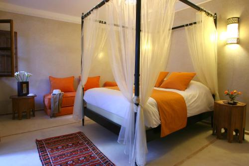 A bed or beds in a room at Riad CHERRATA