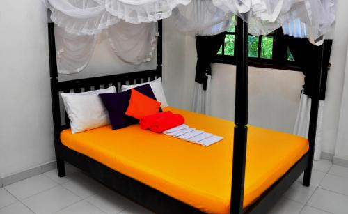 A bed or beds in a room at Bon Accord Mirissa
