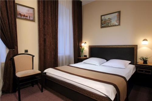 A bed or beds in a room at Eliseeff Arbat Hotel