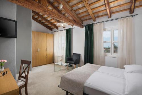 Ein Bett oder Betten in einem Zimmer der Unterkunft Hotel La Grisa