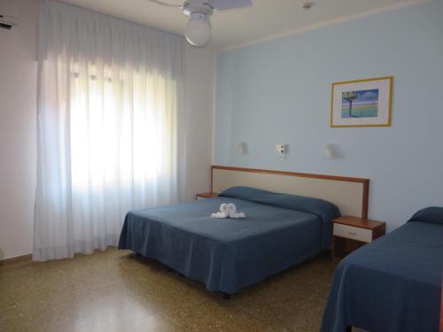 Postel nebo postele na pokoji v ubytování Hotel Maxim