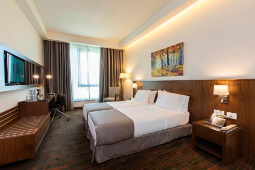 Un ou plusieurs lits dans un hébergement de l'établissement Citea Apart Hotel
