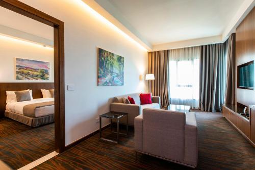 Coin salon dans l'établissement Citea Apart Hotel