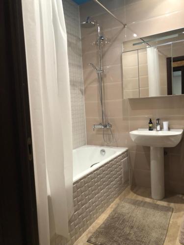 Ванная комната в Apartment Vanilnoe Nebo