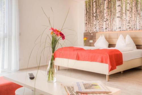 Ein Bett oder Betten in einem Zimmer der Unterkunft Eco Suite Hotel