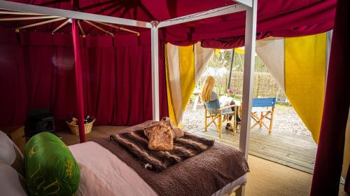 A bed or beds in a room at Knights Glamping at Leeds Castle
