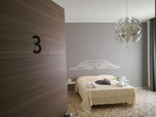 A bed or beds in a room at Spira Mirabilis Napoli