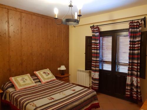 Cama o camas de una habitación en Hostal Pampaneira