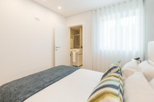 A bed or beds in a room at Art's Braga Apartment - Minho's Guest