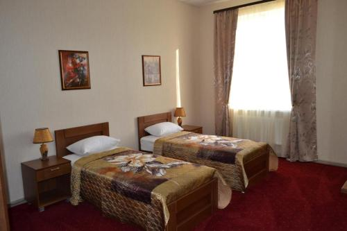 A bed or beds in a room at Hotel Lazurit