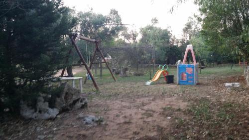 Area giochi per bambini di Campeggio Bungalow Darwin