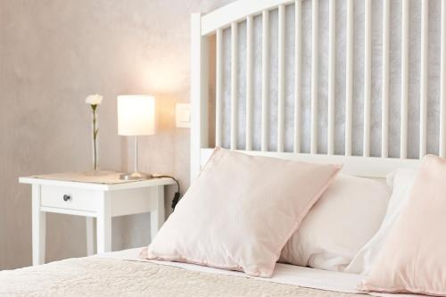 A bed or beds in a room at Villapiana Country House