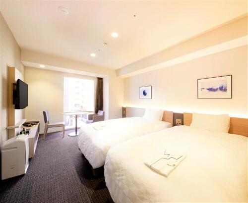 A bed or beds in a room at Tmark City Hotel Tokyo Omori