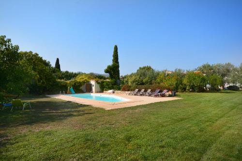 The swimming pool at or near Gîte Des Jonquiers