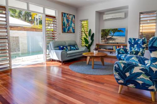 A seating area at Hanalei Beach House Port Douglas
