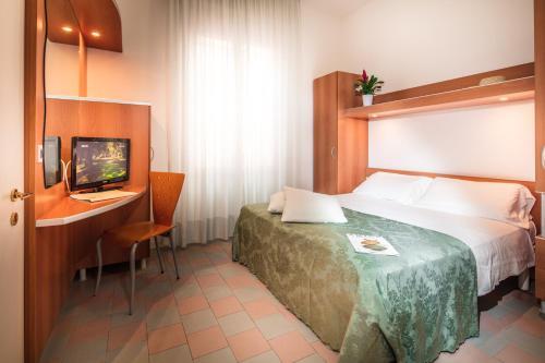Letto o letti in una camera di Park Hotel