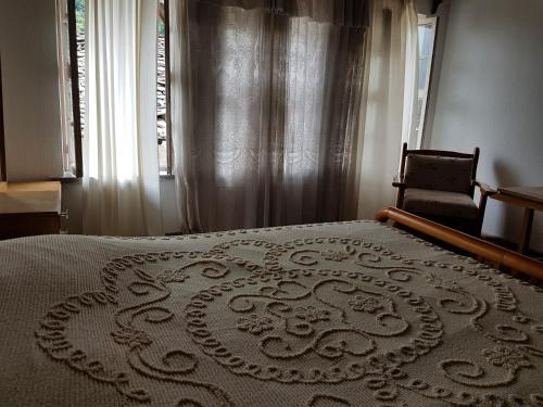 A bed or beds in a room at Eva Guesthouse