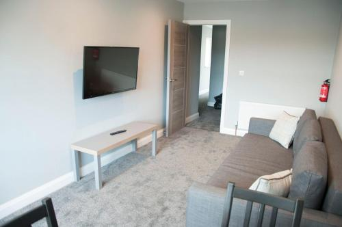 A television and/or entertainment center at The Square Guest Apartment