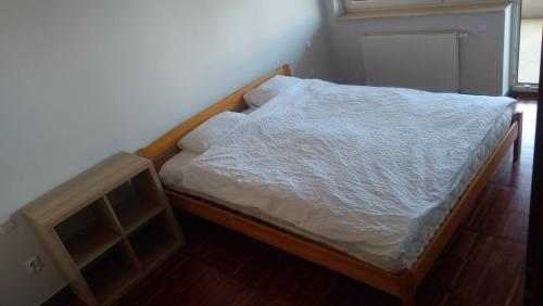 Łóżko lub łóżka w pokoju w obiekcie Mini Lux Apartment