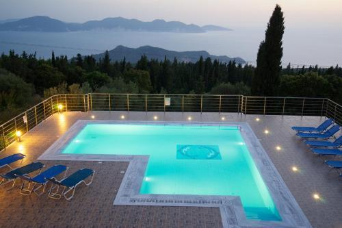 O vedere a piscinei de la sau din apropiere de Studios Vrionis Panoramic Sunset