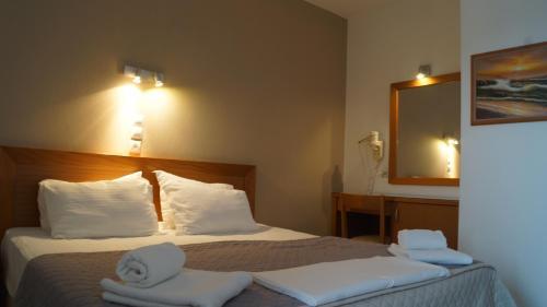 Krevet ili kreveti u jedinici u okviru objekta Sunset Hotel