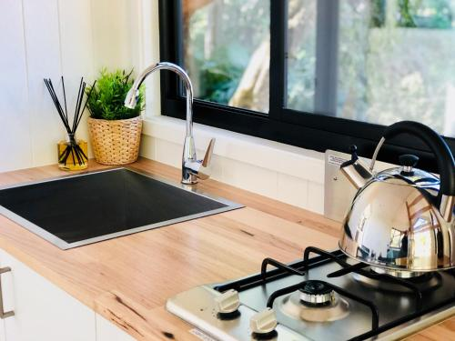 A kitchen or kitchenette at Walden Tiny House