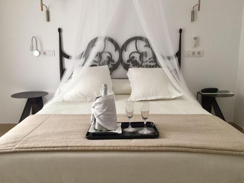 Ein Bett oder Betten in einem Zimmer der Unterkunft Hotel Sa Volta
