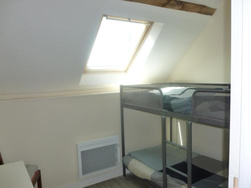 A bunk bed or bunk beds in a room at Les Châtaigniers Gîte