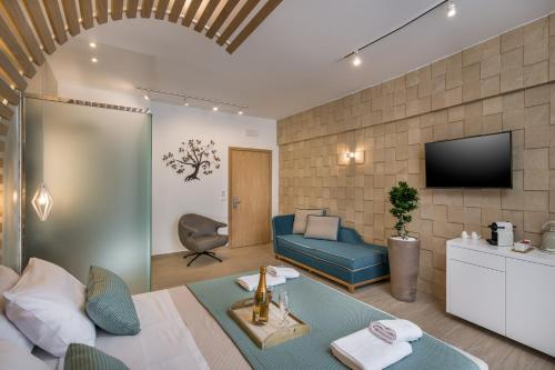 A television and/or entertainment centre at Agave Suites