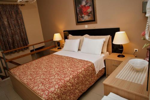 Ένα ή περισσότερα κρεβάτια σε δωμάτιο στο Palmira Apartments