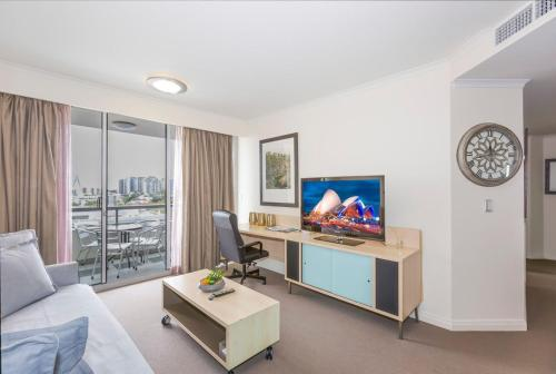 A television and/or entertainment center at Darling Harbour Executive