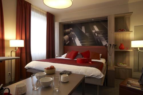 Кровать или кровати в номере Aparthotel Adagio Vienna City