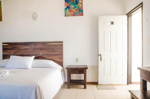 Cama o camas de una habitación en Bungalows Zicatela