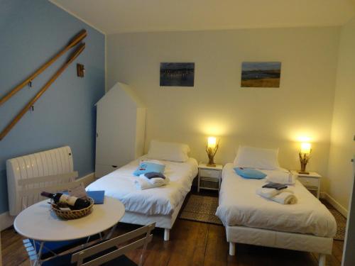 Un ou plusieurs lits dans un hébergement de l'établissement Le Figuier de Pauline