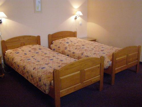 Ein Bett oder Betten in einem Zimmer der Unterkunft Hotel Zatkuv dum