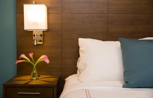 A bed or beds in a room at Staybridge Suites Seattle - South Lake Union