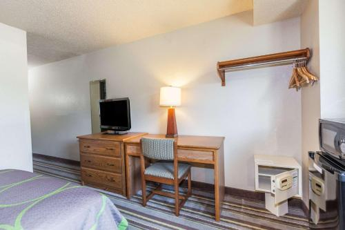 A television and/or entertainment center at Super 8 by Wyndham Dunbar/Charleston Area