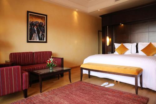 A bed or beds in a room at Kenzi Menara Palace & Resort All Inclusive