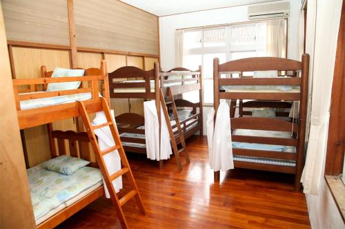 A bunk bed or bunk beds in a room at Emix Ishigaki