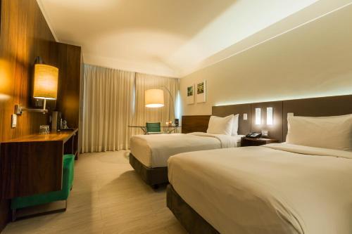 Cama ou camas em um quarto em Bugan Recife Hotel by Atlantica