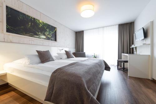 Ein Bett oder Betten in einem Zimmer der Unterkunft Weinstadt Hotel